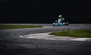Go Karting track with one go kart speeding round a bend